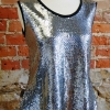 Anns tank sewing pattern made in a silver sequin knit fabric with black edging
