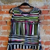 Anns tank sewing pattern made in a multi-colored stripe polyester knit