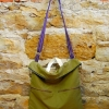 Downtown bag pattern made in green rainwear with purple straps