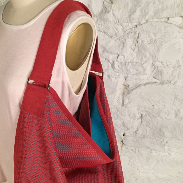 Red mesh Daily News bag pattern with Ultrasuede strap
