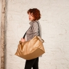 Boulder duffle in quilted coated gold fabric